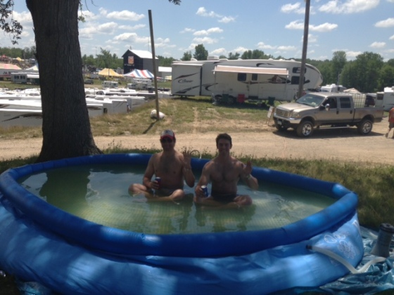 Kevin and Mike sitting in my pool! We filled it with well water, which quickly turned an awkward shade of brown. I think the Porta Kleen team drained it because it looked rancid...